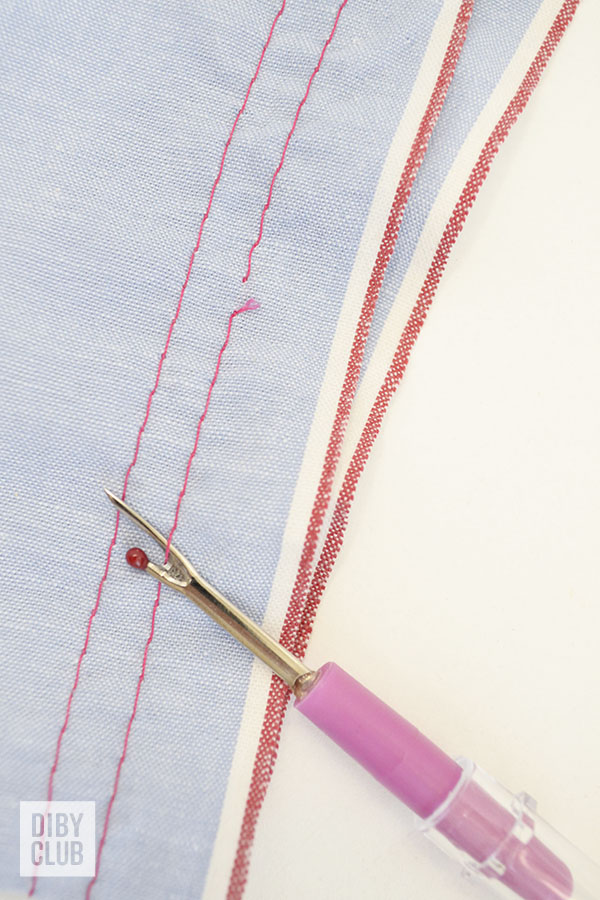 Seam ripper and a basting stitch