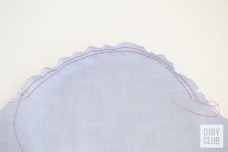 Basting stitches around the cap of a sleeve