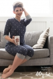 The-Gabriela-Adult-Onesie-Blue-Polka-Dots-Sitting